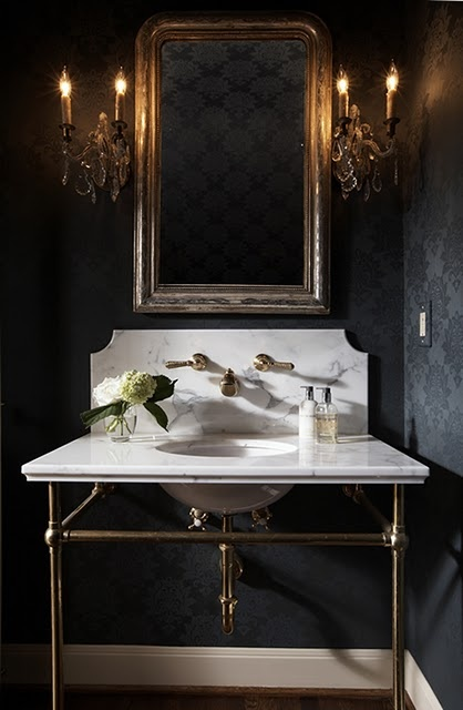 I love the use of this black wall paper!