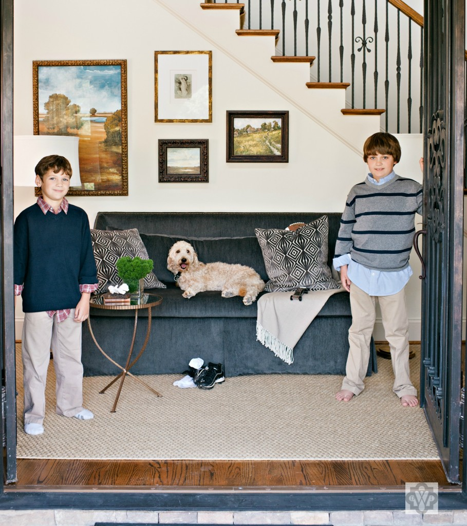 This dog looks just as comfortable as these boys-